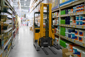 Stacking truck in wholesale warehouse