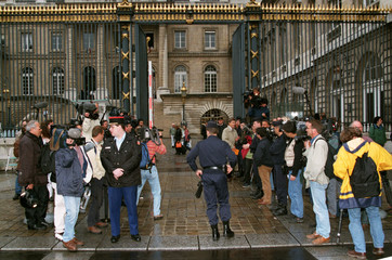 Photographers and television crews are blocked at the gates of the Paris law courts June 5, as the F..
