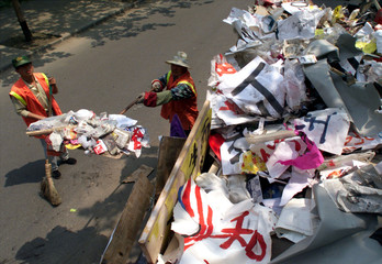 WORKER CLEANS UP AFTER THREE DAYS OF ANTI-NATO PROTESTS IN BEIJING.