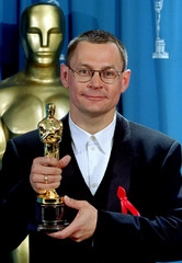 Janusz Kaminski poses March 21st with his Oscar for Best Cinematography in the black-and-white film ..