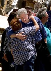 CLINTON HUGS TORNADO VICTIM.