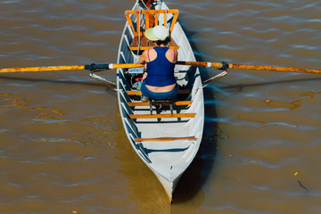 Woman rows in Puerto Madero seen from above, Buenos Aires, Argentina