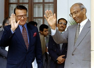 Indian Foreign Secretary K. Raghunath (R) and his Pakistani counterpart, Shamshad Ahmad, wave to jou..
