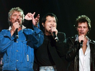 Rod Stewart, Yazawa from Japan and Jon Bon Jovi (L-R) perform at Wembley Arena in London, August 16...