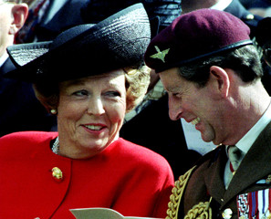 Prince Charles (R) smiles as he talks with Dutch Queen Beatrix during the commemorative service for ..