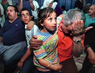 RELEASED PALESTINIAN PRISONER SAMIR MANSOUD CRIES WITH HIS DAUGHTER IN RAMALLAH.