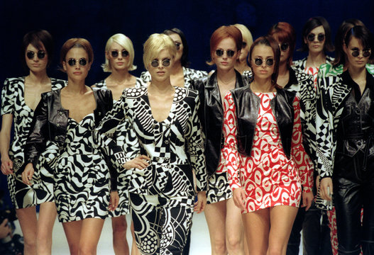 Models for Italian born Emanuel Ungaro present printed skirts and trousers with leather vests as par..
