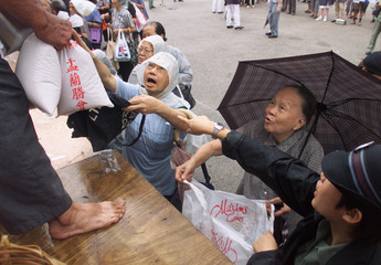 ELDERLY GET FREE RICE AT HUNGRY GHOST FESTIVAL IN HONG KONG.