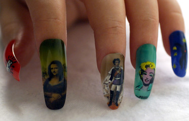 """A model displays artificial nails painted with airbrush with the pictures of """"Mona Lisa, King Ludwig.."""
