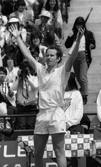 MCENROE OF THE US RAISES ARMS IN VICTORY AFTER WINNING JAPANESE GRAND PRIX TOURNAMENT IN TOKYO.