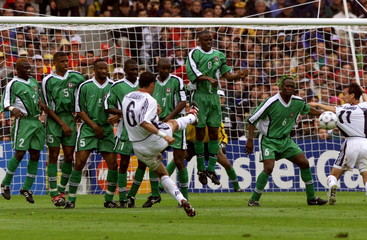 Spain's Fernando Hierro (6) scores a goal from a free kick  against Nigeria during a first-round Wor..