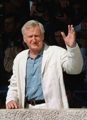"British director John Boorman waves to photographers before a press conference for his film ""Beyond .."
