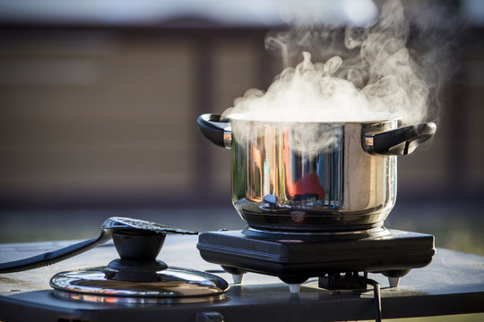 close up standless pot food  cooking on electric stove
