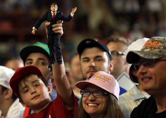 A boy holds a U.S. President Donald Trump doll during a rally marking Trump's first 100 days in office in Harrisburg