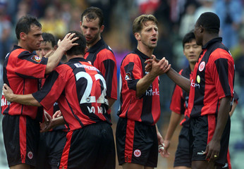 EINTRACHT FRANKFURT PLAYERS CONGRATUALATE EACH OTHER AFTER VICTORY AGAINST UNTERHACHING.