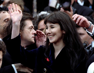 French actress Isabelle Adjani waves to the crowd as she arrives for the screening of '' La Reine Ma..