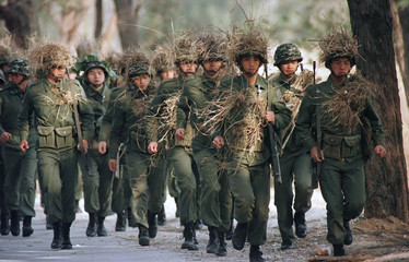 Troops train in camoflage gear in the Taiwan-controlled island of Quemoy (Kinmen) on March 2. Milita..