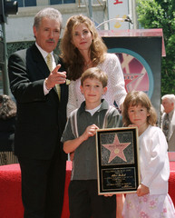 GAME SHOW HIST ALEX TREBEK AND FAMILY WITH HOLLYWOOD STAR.
