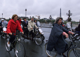 FRENCH MINISTERS HEAD TO ELYSEE PALACE RIDING BICYCLES.