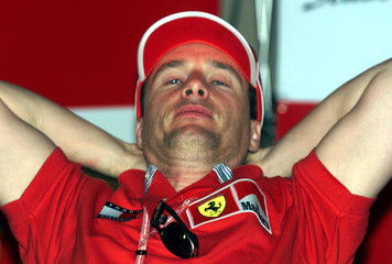 FERRARI FORMULA ONE DRIVER IRVINE RELAXES AT NEWS CONFERENCE.