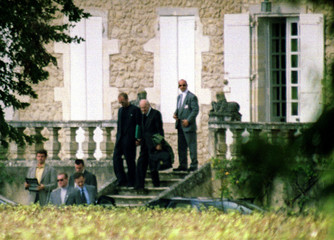 """Accused wartime Nazi collaborator Maurice Papon (C) leaves the mansion """"Perin de Naudine"""" he rented .."""
