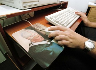 A computer mouse pad with an image of Pope John Paul II is one of more than 100 items which organize..