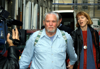 Ira Einhorn , a 1960's American counter-culture guru, leaves court with his present companion Anika ..