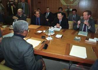 Secretary General Kofi Annan, (left foreground) sits down to meet with envoys representing the five ..