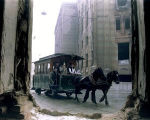 A horsedrawn antique tram passes by the destroyed city library in the old part of Sarajevo November ..