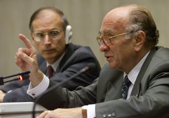 Otto Lambsdorff (R), the chief representative of the German government speaks to reporters while U.S..