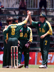 SOUTH AFRICAN CRICKET TEAM CELEBREATES A ZIMBABWE WICKET.