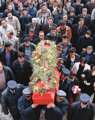 Albanian policemen lead the funeral procession with the dead body of their colleague Arshi Bregasi o..
