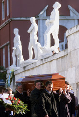 THE COFFIN CONTAING THE BODY OF PRIMO NEBIOLO IS CARRIED BY ATHLETS DURING A MEMORIAL SERVICE IN ROME.