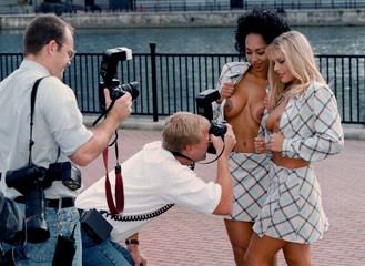 A photograher moves right in for a close up during a photo call promoting London's new adult channel..