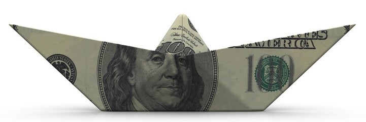 Paper boat from an American banknote on white surface