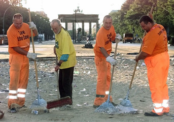 City worker clean the area in front of Berlin's famous landmark the Brandenburg Gate the day after t..