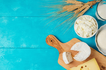 Foto op Aluminium Zuivelproducten Milk and cheese, dairy products on wooden blue background. Jewish holiday Shavuot concept. View from above