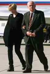 FORMER SOVIET LEADER GORBACHEV WALKS WITH DAUGHTER.