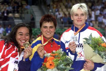 LISA MISIPEKA OF AMERICAN SAMOA, ROMANIA'S MIHAELA MELINTE AND RUSSIA'S OLGA KUZENKOVA HOLD THEIR MEDALS.