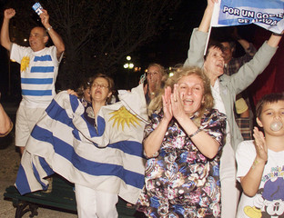 SUPPORTERS OF URUGUAYAN PRESIDENTIAL CANDIDATE BATLLE CELEBRATE FAVORABLE EXIT POLL RESULTS.