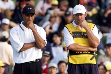 TIGER WOODS STUDIES POSTION WITH HIS CADDY IN TAIWAN.