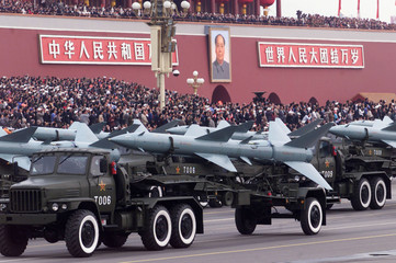 Chinese missiles pass Tiananmen Square in Beijing during a massive parade to celebrate the country's..