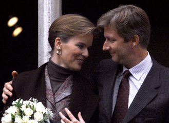 Belgium's Prince Philippe and his fiancee Mathilde d'Udekem d'Acoz look at each other on the balcony..