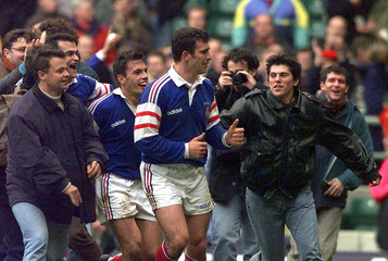 French players and their supporters celebrate following their 23-20 win over England in their Five-N..