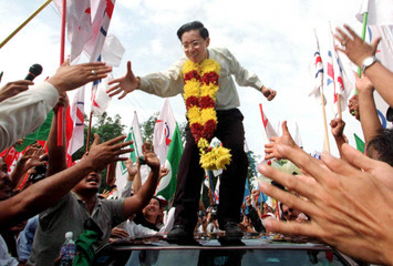 LIM GUAN ENG IS GREETED BY SUPPORTERS OUTSIDE KAJANG PRISON NEAR KUALA LUMPUR.