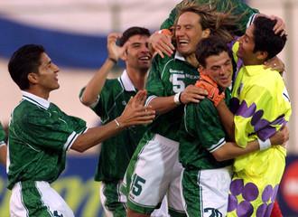 MEXICANS HERNANDEZ GARCIA AND CAMPOS CELEBRATE WIN AGAINST PERU DURING COPA AMERICA QUATERFINAL.