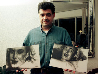 Spanish festival organiser Mario Prades shows January 15 two pictures of  Hollywood legend Marilyn M..