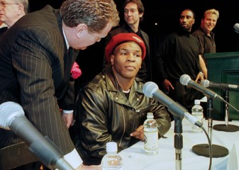 MIKE TYSON AT PRESS CONFERENCE ANNOUNCING FIGHT.