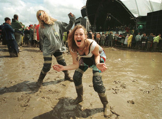 Revellers Amy Last (R) 19-years-old and Katrina Mann (L) 26-year-old both from Suffolk dance in the ..