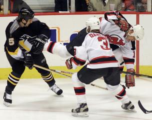DEVILS HOLIK SENT FLYING BY PENGUINS WERENKA IN NHL GAME.